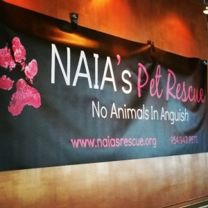 Banner at dog rescue fundraising event
